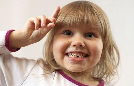 Как вырвать шатающийся зуб